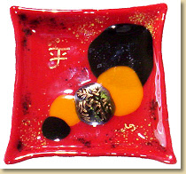 A beautiful red dish, and the Chinese word 'Peace'
