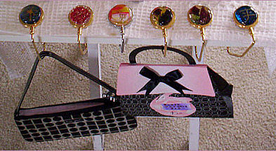 Purse hangers on table